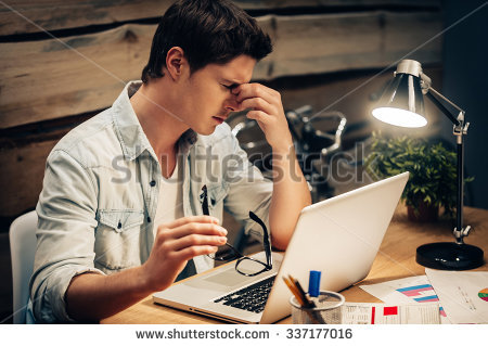 stock-photo-feeling-exhausted-frustrated-young-man-keeping-eyes-closed-and-looking-tired-while-working-late-at-337177016